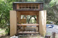 Full-width French doors at end of small cabin in Topanga, California. Built by Mason St. Peter.