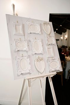 White shabby chic, framed table plan | Photography by http://shuttergoclick.photoshelter.com/