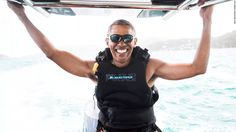 Former President Barack Obama takes on Sir Richard Branson for a kitesurf competition in the British Virgin Islands.