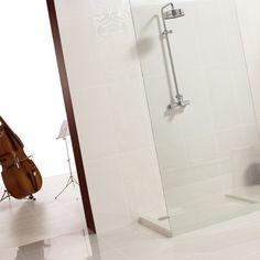 Branco floor tiles add a sleek look to any bathroom