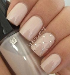 Simple but pretty looking nail art design. A single detailed nail art is painted with silver beads on top and diamond shapes letting it stand out from the rest of the nails