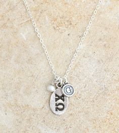 The eternity necklace maybe dainty but it could not hold bigger meaning.  The Chi Omega letters are stamped in a sterling silver charm and hung next to a tiny pearl ~ an important symbol for any Chi O.  The piece is further personalized by adding an initial charm to represent the lucky Tri Delta wearing this special necklace!
