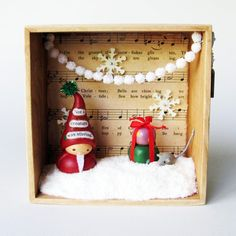 Christmas Eve Assemblage Art Box- One-Of-A-Kind- 3D Diorama featuring Clay Santa Claus, Presents, and Miniature Mouse Sculptures. $125.00, via Etsy.