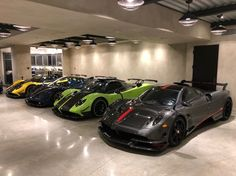 A Pagani Huayra BC in fully exposed Black & Gray carbon fiber w/ Red central stripes, a Pagani Zonda Cinque coupe painted in Green w/ exposed carbon fiber and a Green central stripe, a Pagani Zonda Tricolore in fully exposed Blue carbon fiber w/ Tricolore Pagani Huayra Interior, Pagani Huayra Bc, Lux Cars, Garage Design, Koenigsegg, Blue Accents, Exotic Cars, Concept Cars, Carbon Fiber