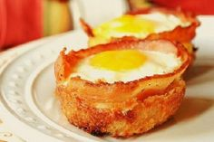 A recipe from my childhood that I've adopted as an adult... Eggs and bacon cooked in a muffin tin. I call them egg and bacon roses because unlike the picture I create a frothy mix of eggs cream and herbs instead of leaving the yolks whole and I put a few curls of bacon throughout the muffin cup to create a rose shape. A sure crowd pleaser for special brunches... - Eat Healthy Stockphoto
