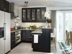 HGTV designers love the look of this black and white kitchen that is small on space but big on style.