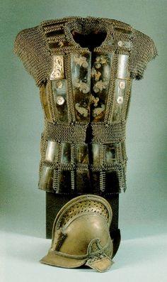 Moro warriors armor, mail and plate shirt, brass European inspired helmet.