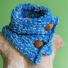 Three blue yarns knit together and fastened with large wooden buttons. I think this is the color of January.