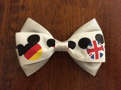 Epcot Inspired Hair Bow by miniPanda on Etsy https://www.etsy.com/listing/205792943/epcot-inspired-hair-bow