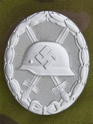 Reproduction German WWII Silver Wound Badge- The 1939 Wound Badge was instituted by Hitler on September 1, 1939. It was to recognize and honor the individuals who were wounded in combat for the Fatherland. The Silver badge was issued for 3rdt and 4th wounds.  These are die-struck badges with L/40 maker mark. Very nice quality and well detailed badge.