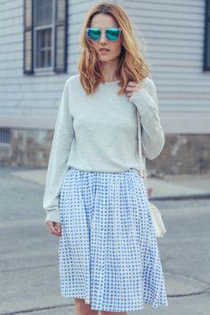 Light grey knit, light blue and white gingham skirt, and white handbag