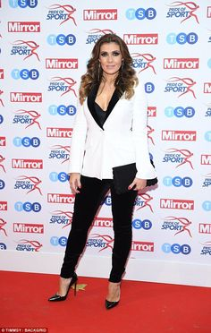 Style statement: Following suit was Corrie star Kym Marsh, who put on a trendy display in a sleek white blazer and tailored trousers