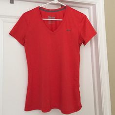 Nike dri-fit t shirt Nike Dri-Fit tshirt. Coral/orange color. Size M. Great condition Nike Tops Tees - Short Sleeve