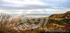 A view of the Chesil Beach from Portland, Dorset in the UK. This section of the…