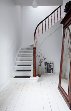 whitewashed wood-panel floors, a curvilinear staircase, and dark-stained wood in iben and niels ahlberg's book, new style generation, gen one (photo and styling by the ahlbergs)