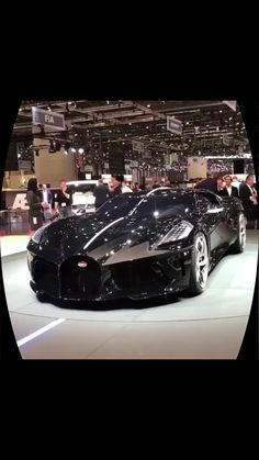 Million dollar car One of the most expensive cars on the market at the auto show.One of the most expensive cars on the market at the auto show. Bugatti Cars, Bmw Cars, Bugatti Veyron, Cars Auto, Ferrari, Top Luxury Cars, Luxury Sports Cars, Ford, Fancy Cars