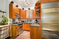 """We love this kitchen inside the famous Murray Hill """"jewel box"""" townhouse. It was remodeled in 2002 with custom cabinetry, a Sub-Zero refrigerator, and state-of-the-art stove and dishwasher. #nyc #townhouse #brownstone #realestate"""