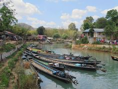 Long-tail boats on the Inn Dein Weir southwest of Inle Lake, Myanmar (Burma), await passengers. Inle Lake, Boats, Ships, Boat