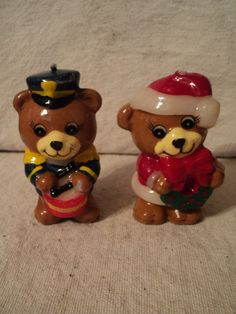 2 of set of 3 bear candles . Blue dresses with drum and Red dresses like Santa with wreath..