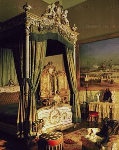 Bedroom of Empress Eugenie in Compiegne,where the couple used to spend weekends with friends. In the background a painting showing the opening of the Suez Canal in 1869,which the Empress attended.