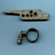 Roman Bronze Lock & Roman Bronze Key Ring  CULTURE / REGION OF ORIGIN: Roman; the lock mechanism said to have been found in the Balkans; the key ring found in Spain.  DATE: 1st-4th Century CE.  http://www.clioancientart.com/catalog/i47.html