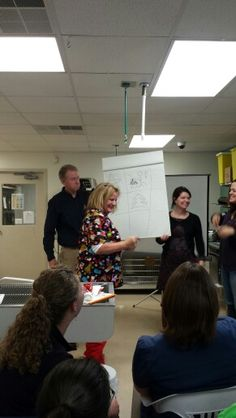 Dave, Jeannie, and Dr. Strong play Holiday Pictionary for the rest of the team!