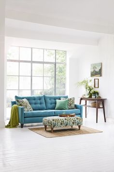 Perfect for creating a summery feeling in your home, Multiyork's beautiful Dexter Buttoned Sofa looks fabulous in this vibrant blue fabric.