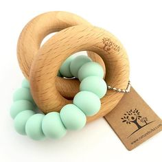 The Mint Scandi Rattle by Nature Bubz is the perfect teething toy to add to a baby shower gift. Stylish and buttery soft for soothing little gums, this is a must have for any expecting mum. $24.95