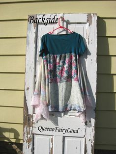 Q438, Up-cycled. The bodice is emerald green with hand sewn silk rose buds on the shoulder. Very pretty. The skirt fabric in the front and back is rayon. The bottom row in the front and back is a sheer silk. The sides are a polyester with pink lace. Throw-On-and-Go Top/Tunic This has