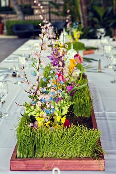 non-traditional floral centerpieces wrapped in wheatgrass {Serendipity Studios}