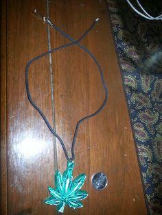 marijuana leaf necklace.