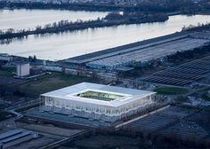 Herzog & de Meuron's Bordeaux Stadium is framed by a forest of slender columns.