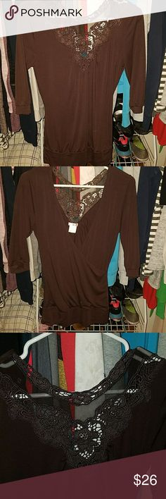 Dressy top Quarter inch sleeve top with lace detail in back and low cut front. Tops