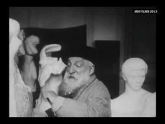 Auguste Rodin - Filmed Sculpting in his Studio (1915) https://www.youtube.com/watch?v=OcGTqxsIUjM He begins sculpting at 1:29 in the video. Love it that you can see stray pieces that he's chiseled off stuck in his beard!