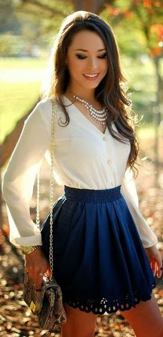 Fantastic Fashion. White Blouse, Blue Skirt and Very Nice Pearl Necklace