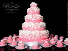 pink wedding cake with minicakes