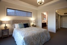 Love the long window across the top of the bed. Lots of light without needing curtains.   Master bedroom with walk-in-robe and ensuite