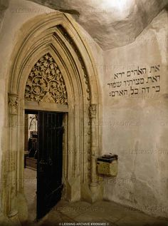 """Gothic portal of """"Alteneuschul"""" in Prague, Europe's oldest synagogue. A tree of life in the tympanon. 1270 Synagogue,"""