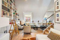 Un apartamento en blanco y madera. ¡No nos lo perdáis!