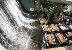 Villa Escudero Waterfall Restaurant  Lunch is served on bamboo dining tables set in a few inches of crystalline running water from the falls. The experience of dining on delicious local dishes with the sparkling waterfalls as a backdrop with clear spring water running over your feet is a truly singular and memorable experience only Villa Escudero can offer.