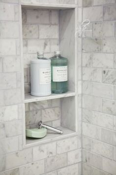 Shower Niche: Like this, but with a subway tile back matching rest of shower, marble sides and top, and probably two marble shelves.