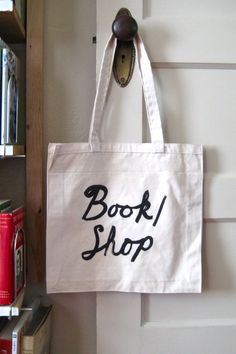 Book Bag    Made for our April pop-up shop at Magasin Général.  Sturdy, 100% cotton canvas tote in Natural, printed in black with the design from our pop-up shop sign.