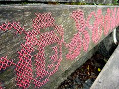 Detail of Cross Stitch on Park Bench, near the sill on the river in Innsbruch, Austria, taken by the girl_onthe_les.