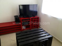 Large red TV table with cava (up to 15 wine bottles) and black center table with two hidden small benches, all made with recycled pallets.