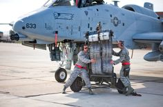 A-10 - Ground crew loading the Warthog cannon.