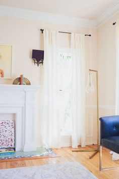 Consider floor-length curtains: http://www.stylemepretty.com/living/2016/03/18/10-ways-to-transform-a-room-for-under-100/: