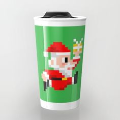 "8-bit Christmas: Santa Claus Ceramic Travel Mug. Because Santa beats Mario's High Score every year! (8bit art, graphics, pixels, retro gamer, video games, lol, funny, xmas, vintage, gift ideas) Double-walled with a press-in suction lid, the two-piece (12oz) design ensures long lasting temperatures while minimizing the risk of spillage from kitchen to car to office. Standing at just over 6"" tall with wrap around artwork, safely sip hot or cold beverages from this one of a kind mug."