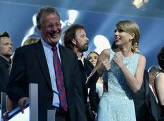 Taylor jamming with Papa Swift at the ACM Awards!