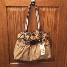 Kathy Purse Kathy purse from Macy's, NWT, beige. Never got around to using this beautiful purse, and now I only use small crossbody's. Kathy Van Zeeland Bags Shoulder Bags