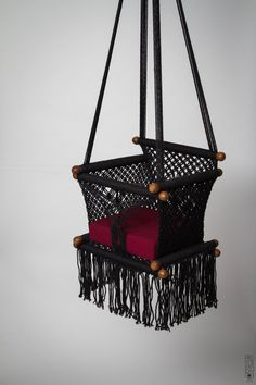 Baby Swing Chair in Macrame Knots. Black color. Safety assembled. TOP QUALITY.   Designer: Hang A Hammock Collective     SUPER GOOD NEWS: YOU CAN TRACK YOUR PARCEL WORLDWIDE      ♥  STANDARD SHIPPING = LESS THAN 15 BUSINESS DAYS WORLDWIDE! ♥     Estimated Time of Arrival (ETA): Processing Time  + Shipping Time    → Processing Time: 5-10 business days (it depend on the number of the orders we have)  → Shipping Time: 2-4 business days  TOTAL FROM YOUR ORDER: less than 15 business days!    ♥  ♥…
